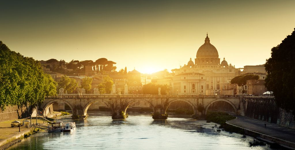 Stroll along the stunning Tiber River...
