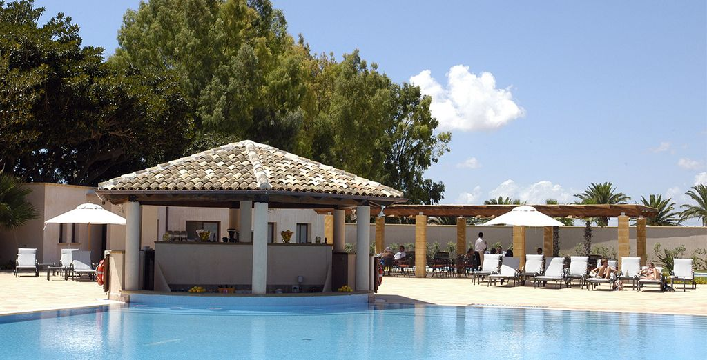 Lounge by the luxurious pool....