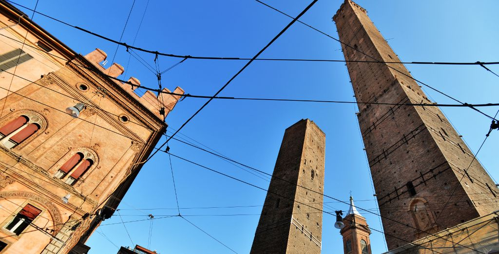 Admire the medieval structures of the Towers of Bologna