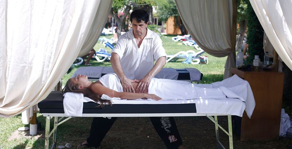 Relax with a spa treatment under a shaded cabana