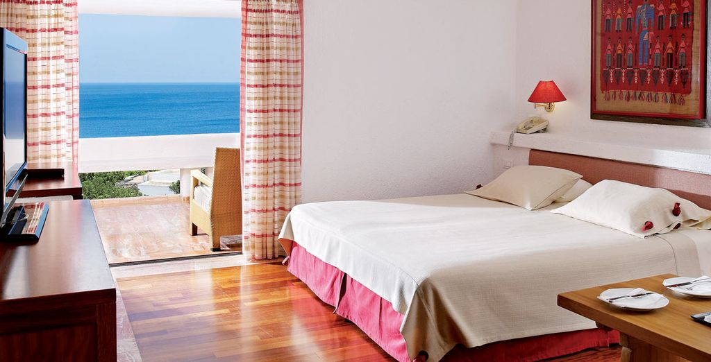 Which are bathed in light (pictured: One Bedroom Sea View Suite)