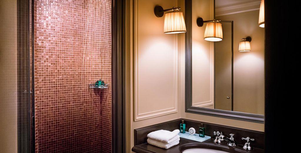Bathrooms feature Hermes toiletries...