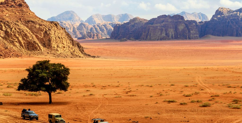 Next, wade through the desert of Wadi Rum on a 4x4 jeep ride