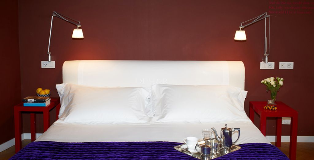 Stay in a room decorated with rich colours and plush furnishings