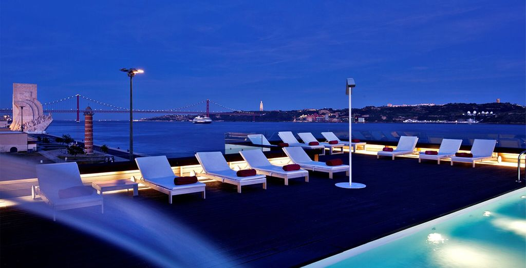 Admire the poolside views as night falls