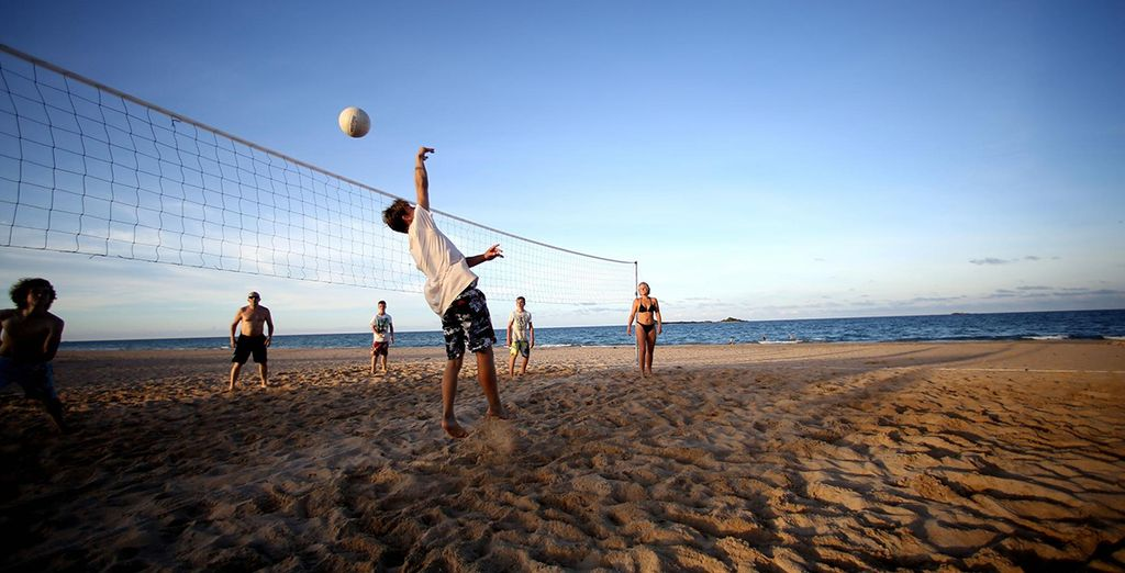 Play a bit of beach volleyball