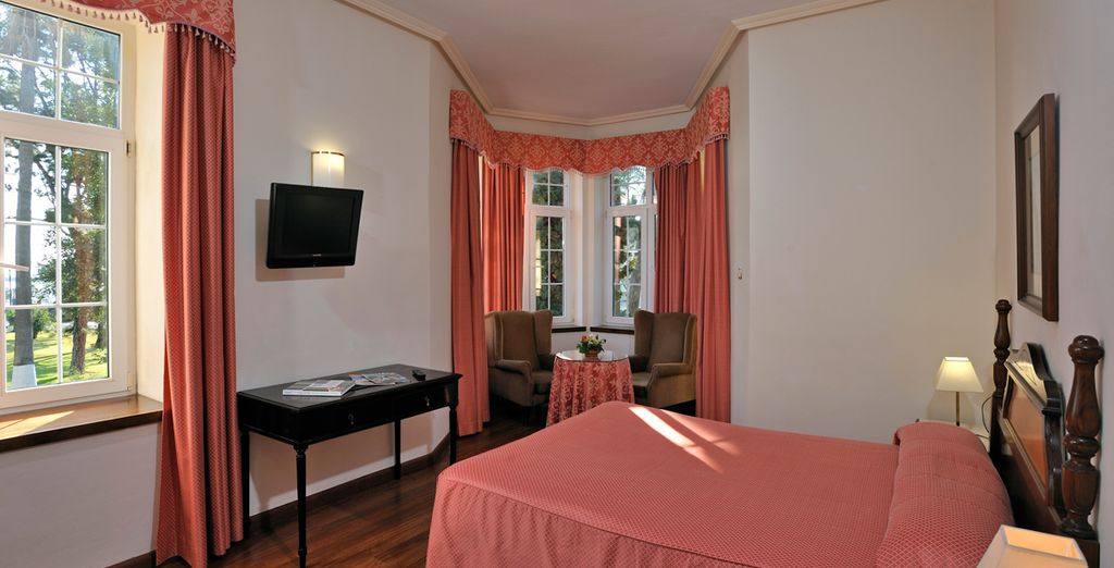 Rooms are simply furnished with dark wood floors, white walls and plush furniture