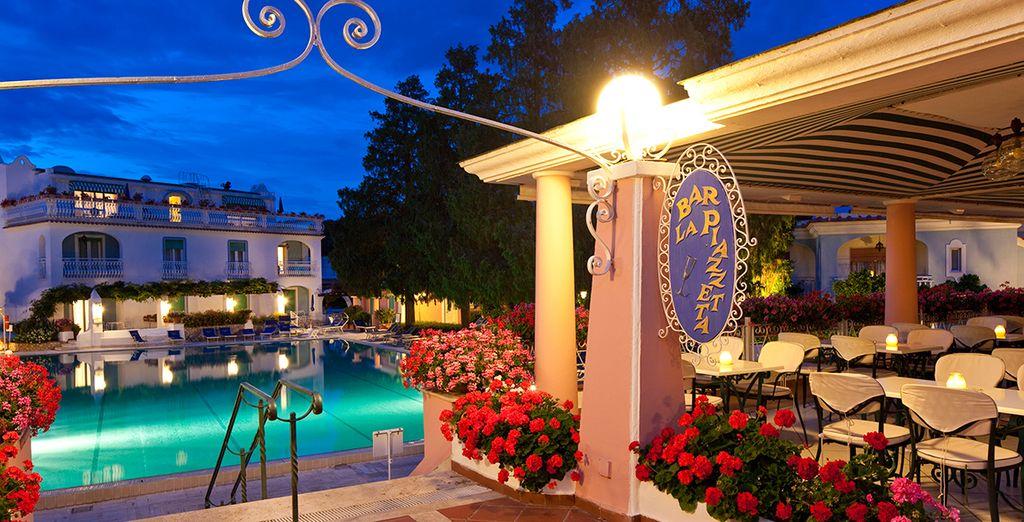 As night falls. dine al fresco by the pool...