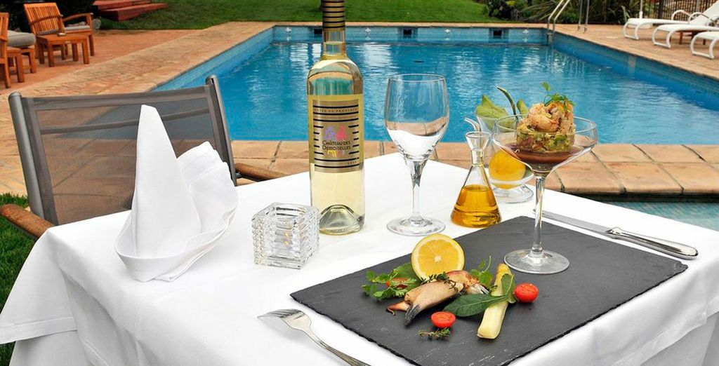 Enjoy a bite to eat by the pool